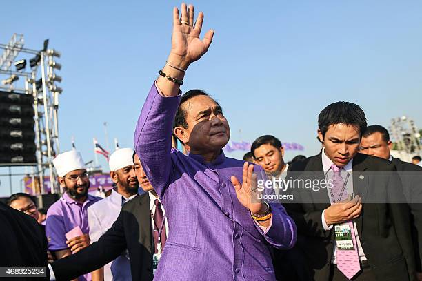 Prayuth Chan-Ocha, Thailand's prime minister and head of the National Council for Peace and Order , waves during a birthday ceremony for Maha Chakri...