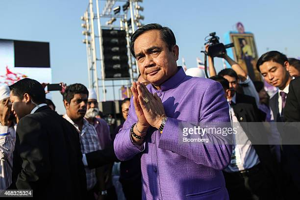 """Prayuth Chan-Ocha, Thailand's prime minister and head of the National Council for Peace and Order , performs the traditional Thai """"wai"""" greeting..."""