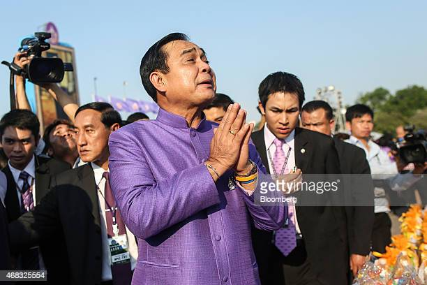 Prayuth Chan-Ocha, Thailand's prime minister and head of the National Council for Peace and Order , speaks while performing the traditional Thai...