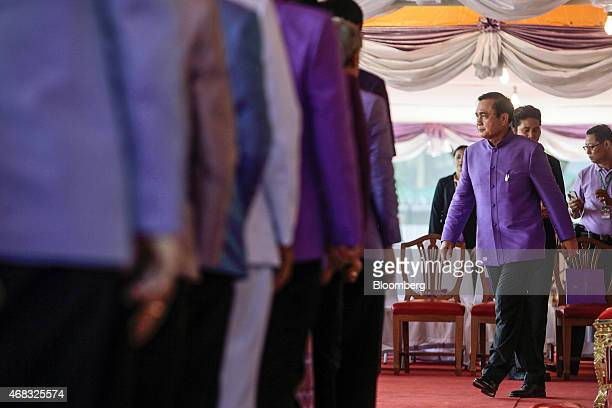 Prayuth Chan-Ocha, Thailand's prime minister and head of the National Council for Peace and Order , right, attends a birthday ceremony for Maha...