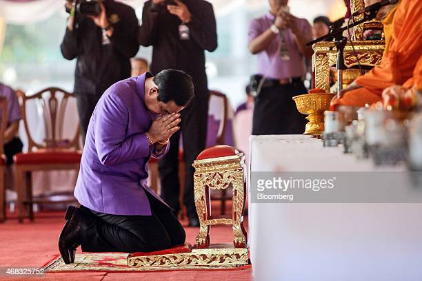 """Prayuth Chan-Ocha, Thailand's prime minister and head of the National Council for Peace and Order , center, performs the traditional Thai """"graab""""..."""