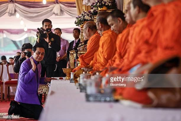 Prayuth Chan-Ocha, Thailand's prime minister and head of the National Council for Peace and Order , center, prepares to perform the traditional Thai...
