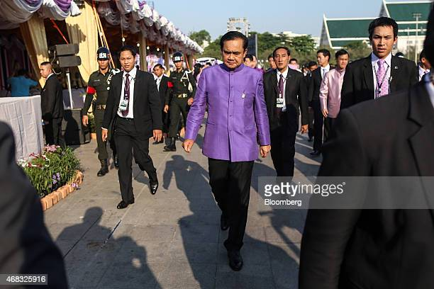 Prayuth Chan-Ocha, Thailand's prime minister and head of the National Council for Peace and Order , center, leaves a birthday ceremony for Maha...