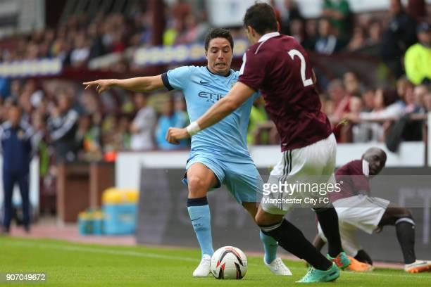 Pre Season Friendly Hearts v Manchester City Tynecastle Stadium Manchester City's Samir Nasri battles for the ball with Hearts' Callum Paterson