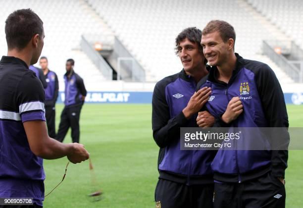 Pre Season Friendly Manchester City v Al Hilal Tivoli Neu Manchester City's Edin Dzeko and Stefan Savic