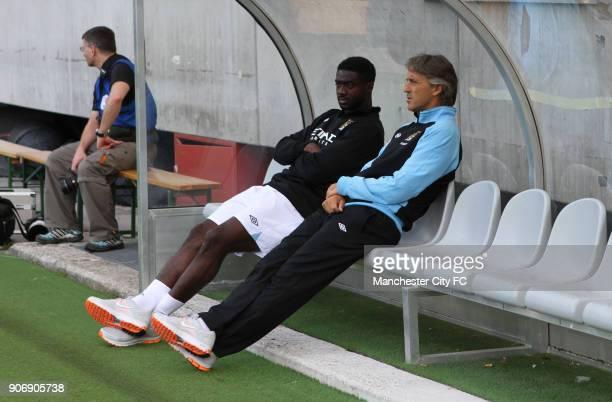 Pre Season Friendly Manchester City v Al Hilal Tivoli Neu Manchester City's manager Roberto Mancini with Kolo Toure on the bench