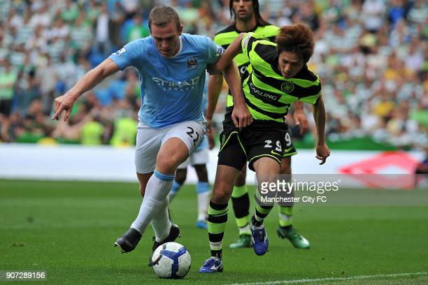 Pre Season Friendly Manchester City v Celtic City of Manchester Stadium Manchester City's Richard Dunne and Celtic's Koki Mizuno