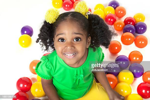 pre shcool black smiling female child with colorful balls