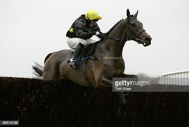 Preacher Boy ridden by Jim Crowley jumps the second to last fence on his way to winning the Guinness Beginners Steeple Chase during the meeting at...