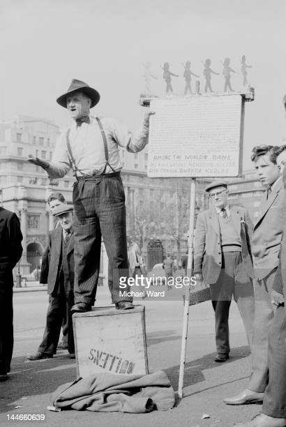 A preacher with a placard listing the world's dams at Speakers' Corner in Hyde Park London with Marble Arch in the background May 1960