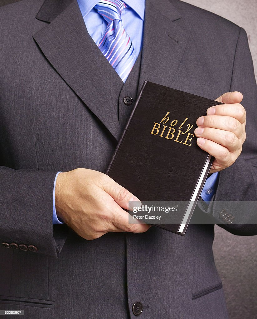 Preacher with bible : Stock Photo