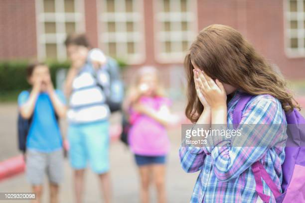 pre-adolescent girl being bullied at school. - nasty little girls stock photos and pictures