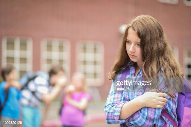 Pre-adolescent girl being bullied at school.
