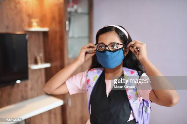 preadolescent girl in school uniform wearing protective face mask - india stock pictures, royalty-free photos & images