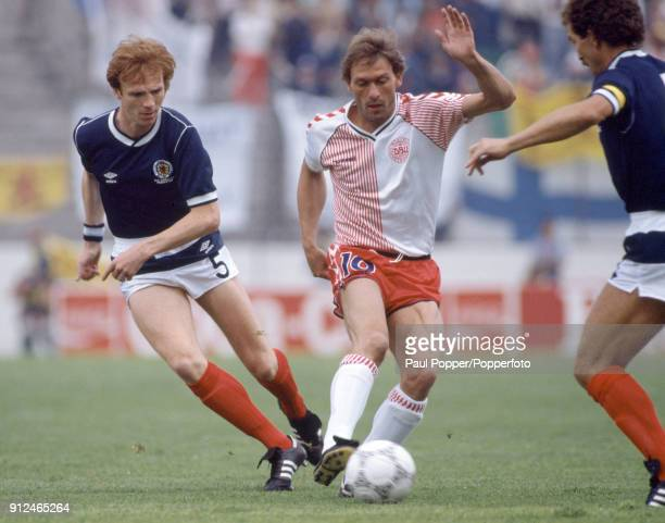 Preben Elkjaer Larsen in action for Denmark watched by Scotland's Alex McLeish and Graeme Souness during the FIFA World Cup match between Scotland...