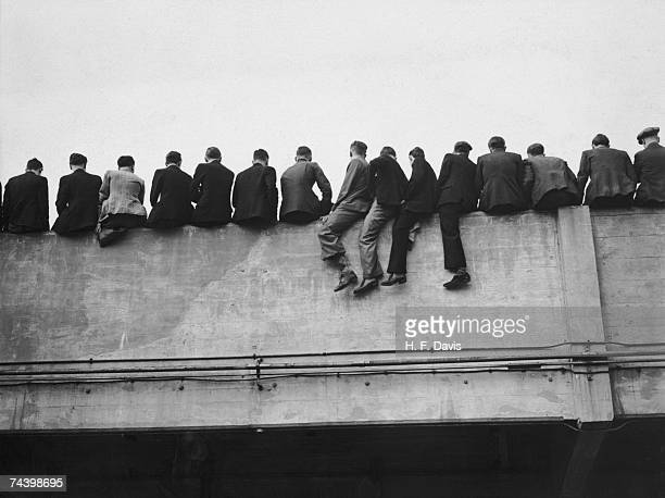 Precarious spectators watching Arsenal's opening game of the season against Portsmouth at the North London club's Highbury Stadium 27th August 1938
