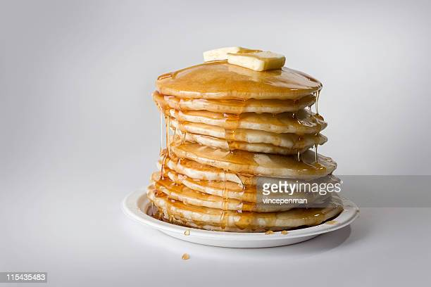 precarious stack of pancakes with syrup and butter - pancake stock pictures, royalty-free photos & images