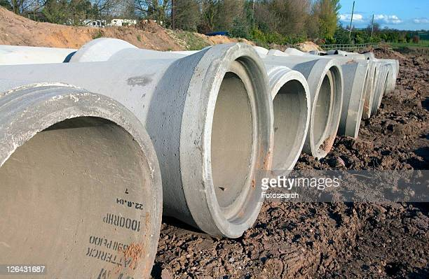 Pre-cast concrete pipes on a side of a motorway