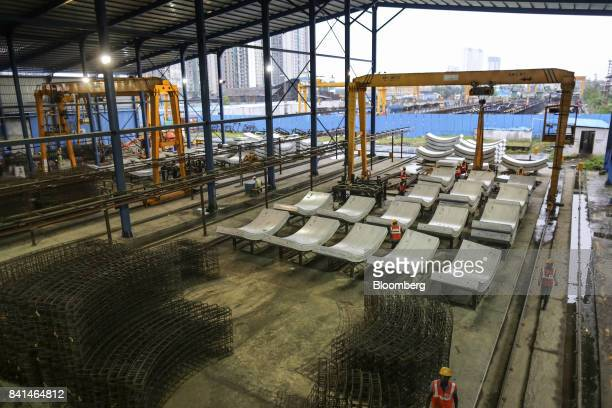 Precast concrete tunnel segments and steel reinforcing frames sit at the Mumbai Metro Rail Corp casting yard in Mumbai India on Monday Aug 28 2017...