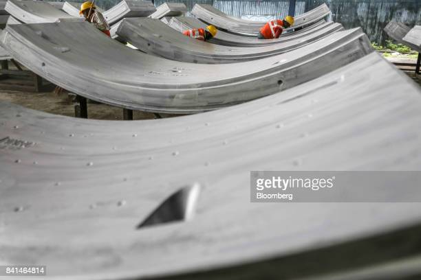 Precast concrete tunnel segments sit at the Mumbai Metro Rail Corp casting yard in Mumbai India on Monday Aug 28 2017 The expanding mega city's...