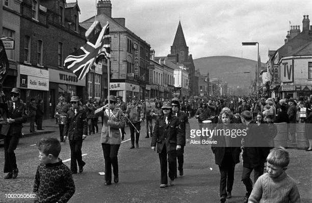 Preceded by the Union Jack members of the Ulster Defence Association a loyalist paramilitary organisation parade along the loyalist Shankill Road in...
