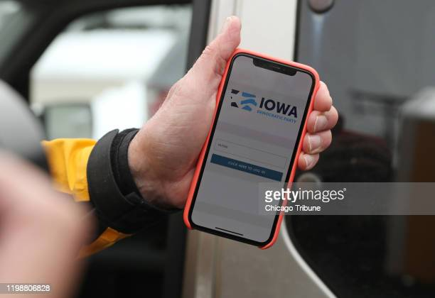 Precinct Chair Carl Voss of Des Moines shows the phone app he used for the Iowa Caucus to news media at the Iowa Democratic Party headquarters on Feb...