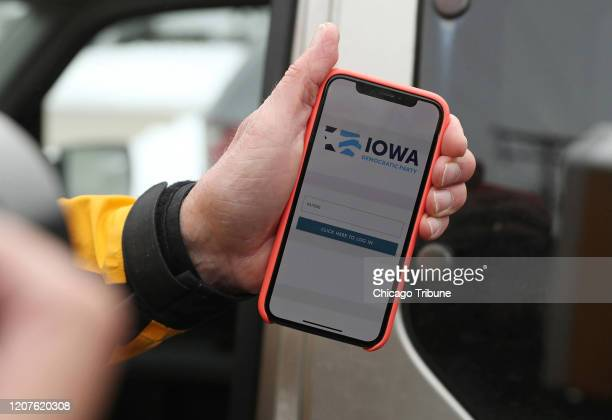 Precinct Chair Carl Voss shows the phone app he used for the Iowa Caucus to news media at the Iowa Democratic Party headquarters on February 4 in Des...