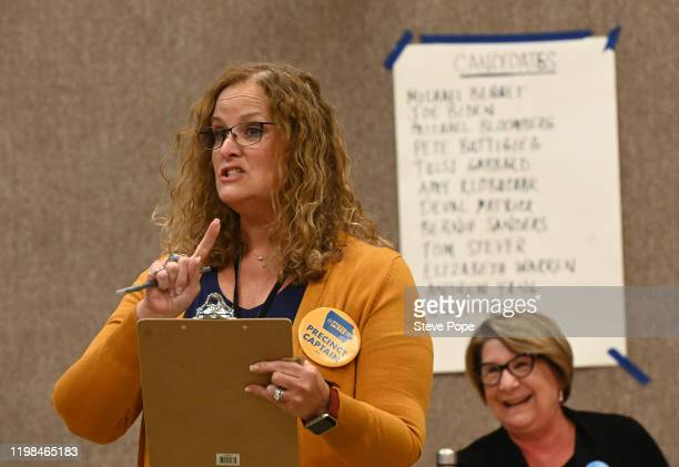 Precinct chairperson Lisa Heimer speaks on behalf of Democratic presidential candidate South Bend Indiana Mayor Pete Buttigieg on February 3 2020 in...