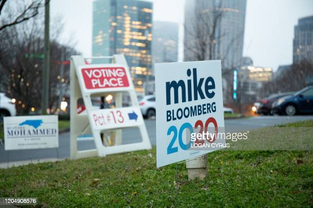 Precinct marker can be seen from the road near a Mike Bloomberg sign near uptown Charlotte during the North Carolina primary on Super Tuesday in...