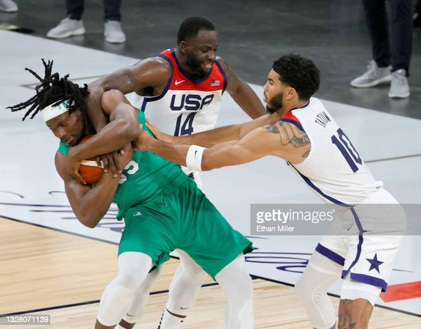 Precious Achiuwa of Nigeria grabs a loose ball as he is fouled by Draymond Green of the United States as Jayson Tatum of the United States defends...