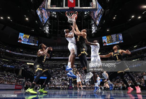 Precious Achiuwa of the Memphis Tigers blocks a shot attempt by Jaime Echenique of the Wichita State Shockers during a game on March 5 2020 at...