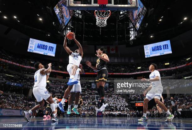 Precious Achiuwa of the Memphis Tigers grabs a rebound against the Wichita State Shockers during a game on March 5 2020 at FedExForum in Memphis...