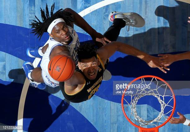 Precious Achiuwa of the Memphis Tigers jumps for a rebound against Jaime Echenique of the Wichita State Shockers during a game on March 5 2020 at...