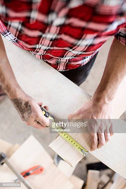 Precise measuring in craft workshop close up