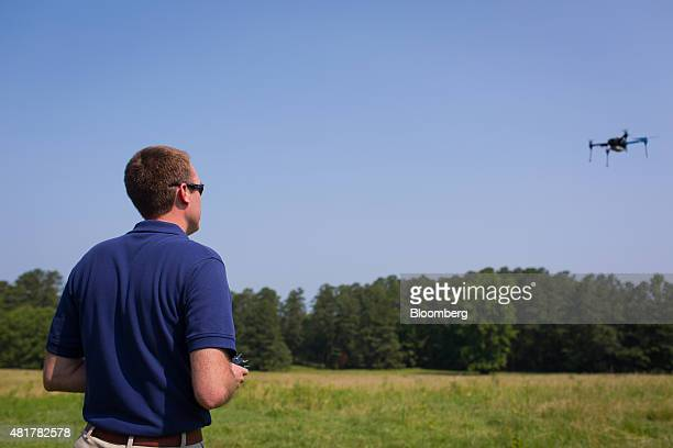 A PrecisionHawk employee demonstrates a drone featuring LATAS in Durham North Carolina US on Tuesday July 7 2015 Google Inc is joining some of the...