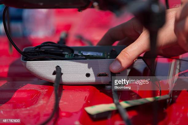 A PrecisionHawk employee prepares for a live demonstration of a drone featuring LATAS in Durham North Carolina US on Tuesday July 7 2015 Google Inc...