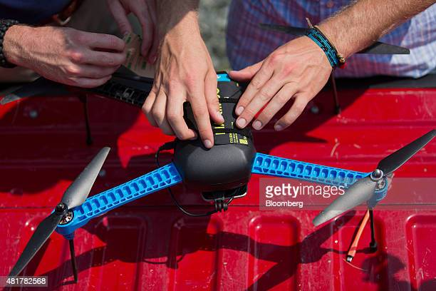 PrecisionHawk employees prepare for a live demonstration of a drone featuring LATAS in Durham North Carolina US on Tuesday July 7 2015 Google Inc is...