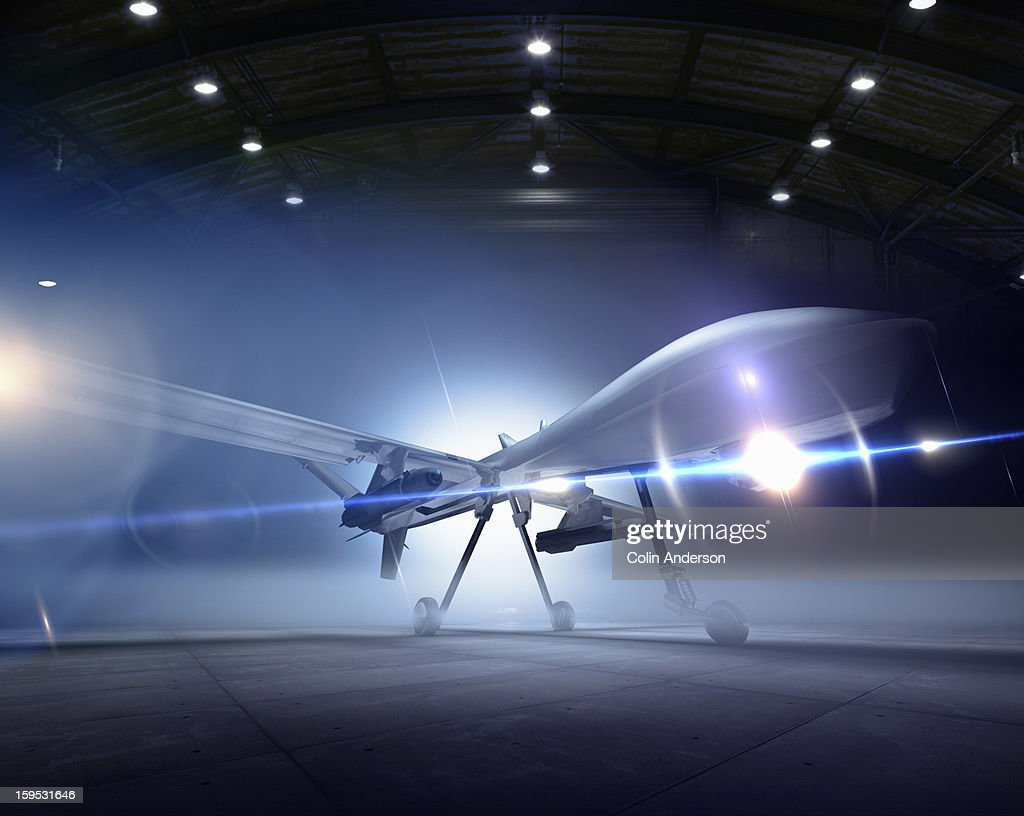 Predator drone at the ready in a hangar : Stock Photo