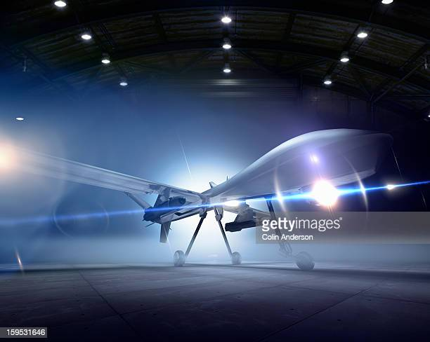 predator drone at the ready in a hangar - military drones stock photos and pictures