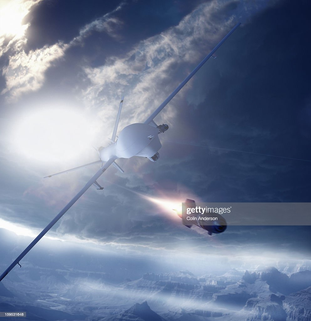 Predator Drone Firing A Missile Stock Photo