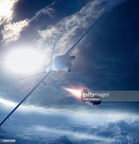 predator drone firing a missile - military drones stock photos and pictures
