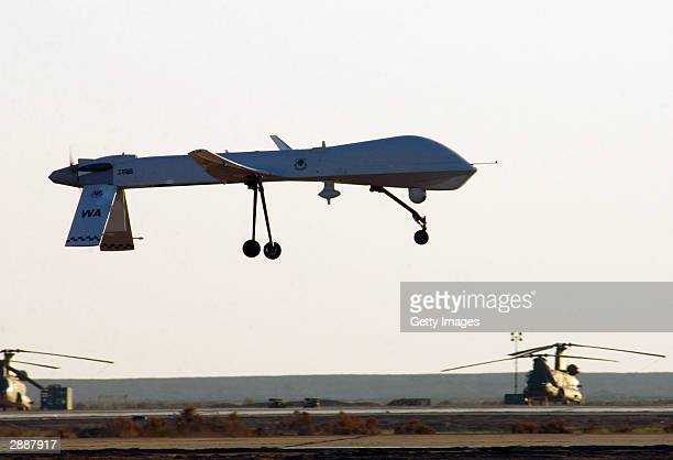 Predator from the 46th Expeditionary Reconnaissance Squadron lands January 20 2004 at Tallil Air Base Iraq The Predator is a remotely piloted vehicle...