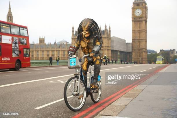 Predator riding bike in London;