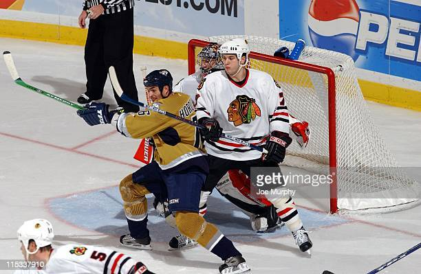 Predators Darcy Hordichuik fights for position in front of the net in the third period. The Nashville Predators beat the Chicago Blackhawks 5-3 on...