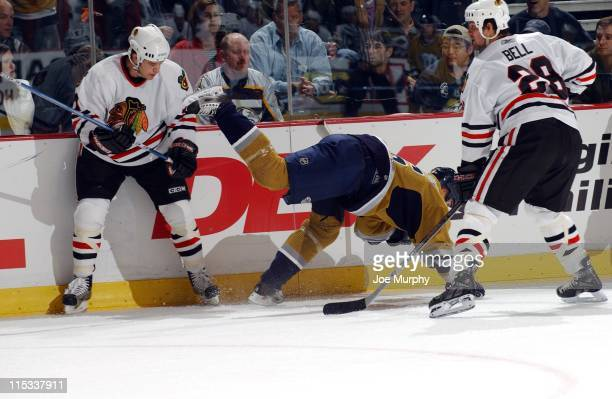 Predators Darcy Hordichuk is tripped up in the first period between the Chicago Blackhawks and the Nashville Predators on October 25, 2005.
