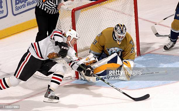 Predators goalie Tomas Vokoun is ready to stop the shot attempt of Blackhawks in the third period. The Nashville Predators beat the Chicago...