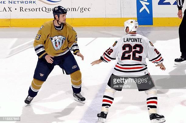 Predators Jamie Allison and Martin Lapointe set to fight in the third period. The Nashville Predators beat the Chicago Blackhawks 5-3 on October 25,...