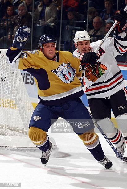 Predators Steve Sullivan battles with Matthew Barnaby in the second period. The Nashville Predators beat the Chicago Blackhawks 5-3 on October 25,...