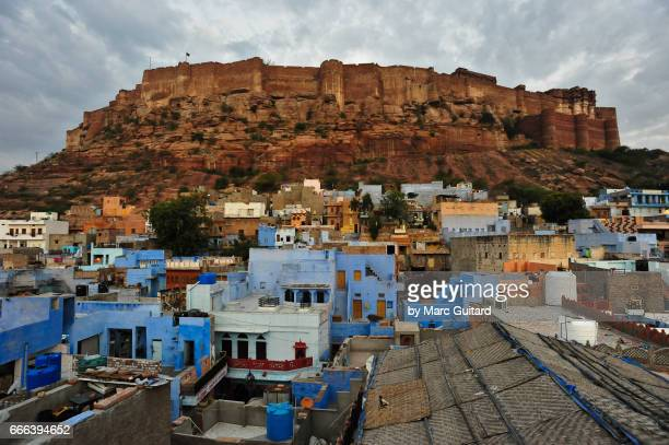 A pre-dawn view of Mehrengarh Fort rising above the rooftops of Jodhpur, Rajasthan, India