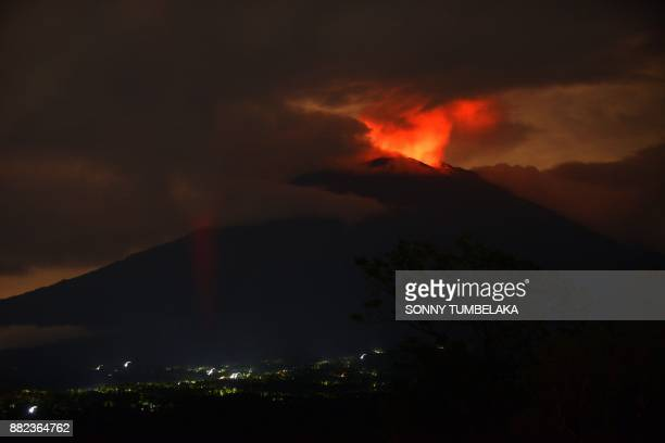 A predawn view shows the erupting Mount Agung volcano from the Kubu subdistrict in Karangasem Regency on Indonesia's resort island of Bali on...